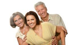 有女儿的年长父母 库存照片