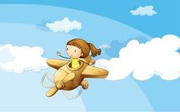 有女孩的一架木飞机 免版税库存图片