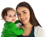 有女婴的愉快的微笑的母亲 免版税库存图片