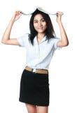 有她的书的年轻亚裔学生在头 免版税库存照片
