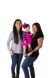 有她的十几岁的女儿和小女儿的一个母亲 库存照片