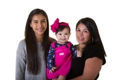 有她的十几岁的女儿和小女儿的一个母亲 库存图片