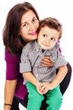 有她的孩子的愉快的母亲一起 免版税图库摄影
