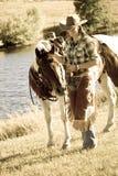 有她的马的妇女 库存照片