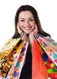 有她的购物袋的美丽的少妇 库存图片