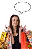 有她的购物袋的美丽的少妇 免版税库存图片