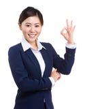 有好的符号的女商人 免版税库存图片