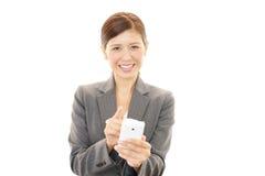 有妇女的巧妙的电话 库存照片