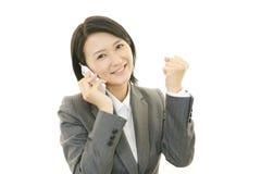 有妇女的巧妙的电话 图库摄影