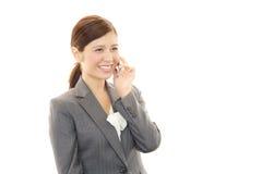 有妇女的巧妙的电话 免版税库存照片