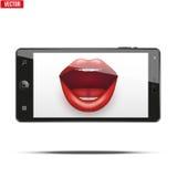 有妇女的嘴唇的智能手机在屏幕上 免版税库存照片