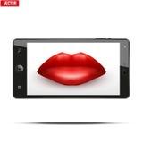 有妇女的嘴唇的智能手机在屏幕上 库存图片