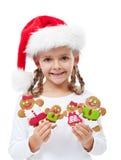 有姜饼人系列的愉快的小女孩 免版税库存图片