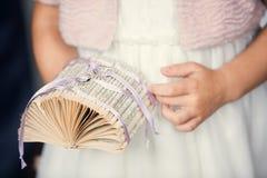 有婚戒的小女孩在她的手上 库存照片