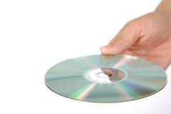 有媒介圆盘的手 免版税库存图片