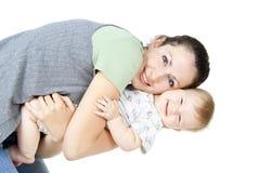 有子项的美丽的愉快的母亲 免版税库存照片