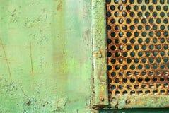 有孔的铁板材用老油漆盖 库存图片