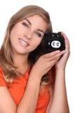 有存钱罐的妇女 免版税库存图片