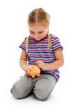 有存钱罐的小女孩 库存照片