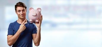 有存钱罐的微笑的人 库存图片