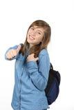 有学校的微笑的美丽的十几岁的女孩挑运 免版税库存照片