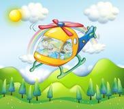 有孩子的一架直升机 库存照片