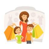 有孩子的愉快的妇女购物的 库存图片