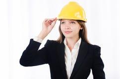 有安全帽的俏丽的女实业家 库存照片