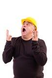 有安全帽的尖叫的工作者 免版税库存图片