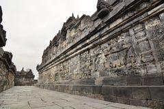 有安心的一个走廊在墙壁上 Borobudur寺庙 马格朗 中爪哇省 印度尼西亚 库存图片