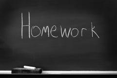 有家庭作业标志的黑板 免版税库存图片