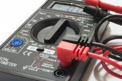 有导线的多用电表仪器在白色背景 图库摄影