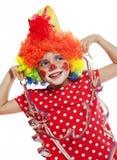 有小丑服装的小女孩 库存图片