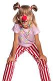 有小丑鼻子的小女孩 免版税库存照片