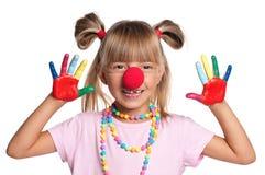 有小丑鼻子的小女孩 免版税图库摄影