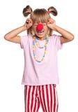 有小丑鼻子的小女孩 免版税库存图片
