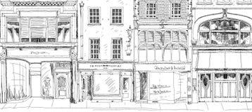 有小商店的老英国在底层上的城内住宅或事务 剪影汇集 库存照片