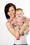 有小婴孩的愉快的母亲 免版税库存图片