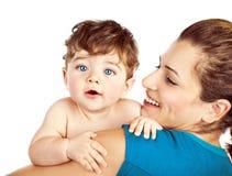 有小婴孩的愉快的母亲 免版税图库摄影