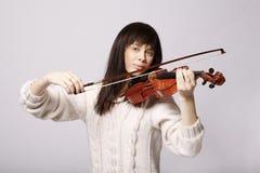 有小提琴的美丽的女孩 库存照片
