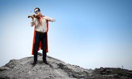 有小提琴的超人 库存图片