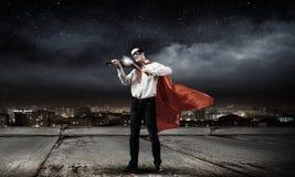 有小提琴的超人 免版税图库摄影