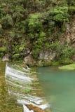有小瀑布的山河 库存图片