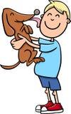 有小狗动画片的男孩 库存照片