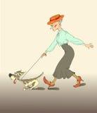 有小狗的夫人 免版税库存图片