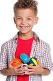 有小的球的男孩 库存照片