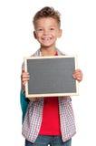 有小的黑板的男孩 库存照片