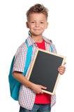 有小的黑板的男孩 库存图片