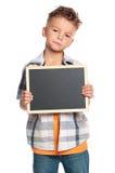 有小的黑板的男孩 免版税图库摄影
