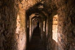 有小窗口的长的隧道 库存照片